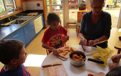 making peach cobbler- We harvested the peach from our orchard as well.jpg